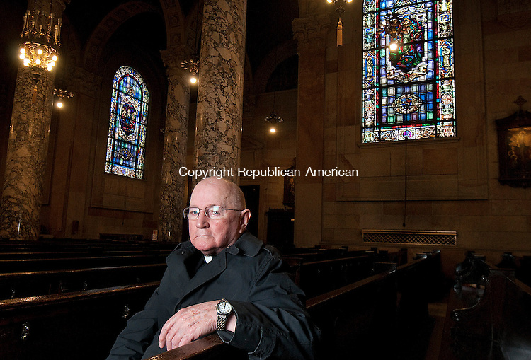 WATERBURY, CT--042315JS01- Fr. John Bevins is retiring as longtime head of the Basilica of the Immaculate Conception in Waterbury. <br /> Jim Shannon Republican-American