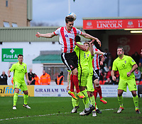Lincoln City's Sean Raggett gets above the York City defence<br /> <br /> Photographer Andrew Vaughan/CameraSport<br /> <br /> Buildbase FA Trophy Semi Final Second Leg - Lincoln City v York City - Saturday 18th March 2017 - Sincil Bank - Lincoln<br />  <br /> World Copyright &copy; 2017 CameraSport. All rights reserved. 43 Linden Ave. Countesthorpe. Leicester. England. LE8 5PG - Tel: +44 (0) 116 277 4147 - admin@camerasport.com - www.camerasport.com