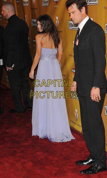 STACY FERGUSON aka Fergie & JOSH DUHAMEL.At Weinstein Company Post Golden Globe Party held at Bar210 & Plush Ultra Lounge in Beverly Hills, California, USA. January 17th, 2010                                                                   globes full length black eyed peas bep purple strapless maxi dress black suit married husband wife profiel back behind rear.CAP/DVS.©Debbie VanStory/Capital Pictures