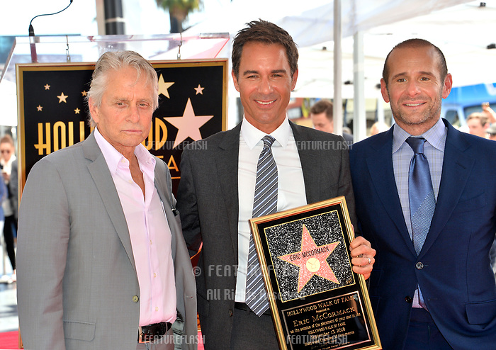 "LOS ANGELES, CA. September 13, 2018: Michael Douglas, Eric McCormack & Max Mutchnick at the Hollywood Walk of Fame Star Ceremony honoring ""Will & Grace"" star Eric McCormack."