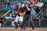 Rochester Red Wings catcher Dan Rohlfing #52 looks for a pop up in front of umpire Ryan Blakney during a game against the Scranton Wilkes-Barre RailRiders on June 19, 2013 at Frontier Field in Rochester, New York.  Scranton defeated Rochester 10-7.  (Mike Janes/Four Seam Images)