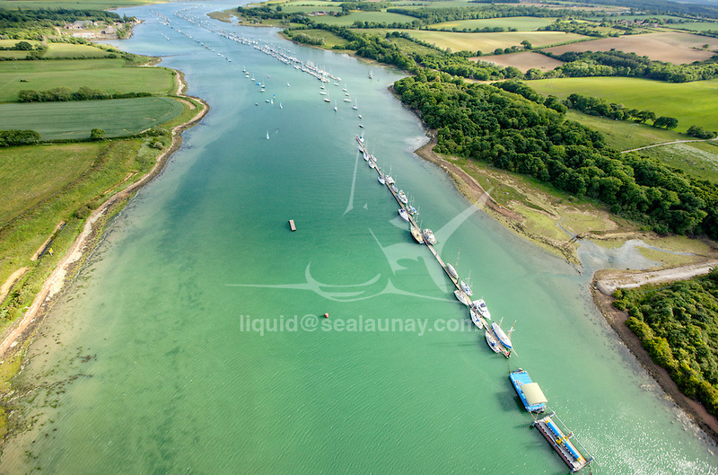 Medina River.<br /> The Solent is the strait that separates the Isle of Wight from the mainland of England. It is about 20 miles long and varies in width between two and a half and five miles, <br /> The Solent is a major shipping lane for passenger, freight and military vessels.