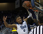 Nevada forward Tre'Shawn Thurman (0) blocks the shot of Utah State forward Neemias Queta (23) in the second half of an NCAA college basketball game in Reno, Nev., Wednesday, Jan. 2, 2019. (AP Photo/Tom R. Smedes)
