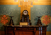 An old clock on a credenza in the governor's office of the Michigan State Capitol, which opened on January 1, 1879 in Lansing, Michigan on Saturday, June 29, 2018. It was designed by architect Elijah E. Myers, and is one of the first state capitols to be topped by a lofty cast iron dome, that was modeled on the dome of the United States Capitol in Washington, DC. <br /> Credit: Ron Sachs / CNP