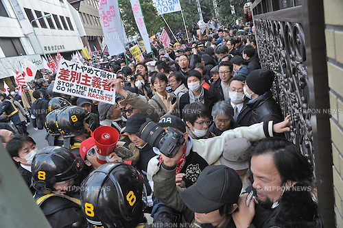 "Anti-racist Japanese clashed with members of the ultra-right Zaitokukai (""Citizens against the Special Privileges of Koreans in Japan"") in Tokyo's Ikebukuro district on March 16, 2014. About 100 members of Zaitokukai went on a protest march, but were confronted by some 300 anti-racist activists."