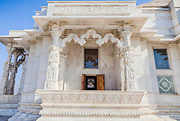 Jaipur, Rajasthan, India.  Religious Syncretism.  Birla Mande Temple, also known as the Laxmi Narayan Temple, a Hindu Temple dedicated to Lord Vishnu (Narayan) and his consort Lakshmi.  Carved figures of Jesus (left) and Moses (right) on the columns flank the two sides of the balcony.