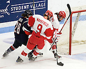 Kayla Tutino (BU - 8) was able to score on the rebound. - The Boston University Terriers defeated the visiting University of Connecticut Huskies 4-2 on Saturday, November 19, 2011, at Walter Brown Arena in Boston, Massachusetts.