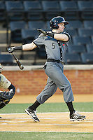 Ian Happ (5) of the Cincinnati Bearcats follows through on his swing against the Wake Forest Demon Deacons at Wake Forest Baseball Park on February 21, 2014 in Winston-Salem, North Carolina.  The Bearcats defeated the Demon Deacons 5-0.  (Brian Westerholt/Four Seam Images)