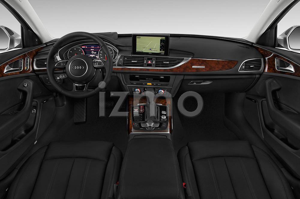 Stock photo of straight dashboard view of 2016 Audi A6  TDI quattro tiptronic Prestige  4 Door Sedan