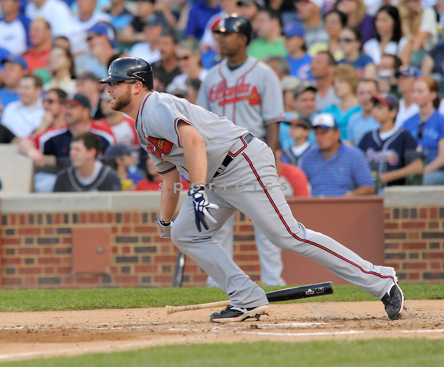 BRIAN MCCANN, of the Atlanta Braves in action  during the Braves  game against the  Chicago Cubs, The Cubs beat the Braves 4-2 in Chicago, Illinois on July 6, 2009...David Durochik