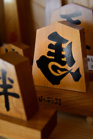 Shogi piece ornaments. Nakajima Seikichi Shoten, Tendo, Yamagata Prefecture, Japan, February 19, 2018. The city of Tendo in Yamagata Prefecture is famous for its shogi (Japanese chess) playing pieces. Production started early in the 19th century and Tendo still produces over 95% of the Shogi pieces made in Japan.