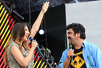 I conduttori Virginia Raffaele e Francesco Pannofino sul palco del tradizionale concerto del Primo Maggio organizzato da Cgil, Cisl e Uil in piazza San Giovanni, Roma, 1 maggio 2012..Show hosts Virginia Raffaele, left, and Francesco Pannofino on stage during the traditional May Day concert in St. John Lateran's Square, Rome, 1 may 2012..UPDATE IMAGES PRESS/Riccardo De Luca