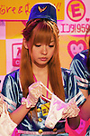 """Japanese adult movie actress donates her lingerie for a 24 hour telethon event with the aim of raising money for a Stop AIDS charity on August 30, 2014 in Tokyo, Japan. The adult movie stars allowed fans to feel their breasts in return for a donation to the AIDS charity. The 12th annual 24 hour TV event """"Eroticism Saves the Earth Telethon"""" is organized by Sky Perfect Tv Adult Chanel with motto """"Social contribution while enjoying the erotic"""". Fans are given the chance to interact with some of the channels leading actresses in the live broadcast event that runs from Saturday afternoon through until Sunday 20:00 hrs. The organizers expect to attract around 2000 fans raising JPY 2 million (US$20, 000) over the weekend. (Photo by Rodrigo Reyes Marin/AFLO)"""