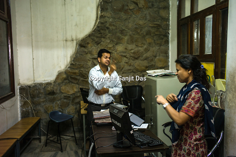 Runa Roka (54), founder of the Noida Deaf Society speaks with one of her staff members at the foundation in NOIDA, India.