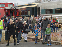 NWA Democrat-Gazette/ANDY SHUPE<br /> Families exit a passenger train Saturday, Dec. 1, 2018, during the annual Christmas Train at the Arkansas &amp; Missouri Railroad in Springdale. The event features a 40-minute ride to Johnson and back aboard a 1940s-era passenger car with Christmas carols. Santa Claus sat for photographs with families in a caboose while games and pony rides were available at the depot.