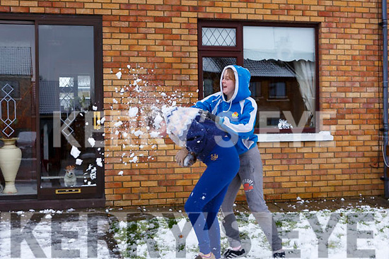 Emma and Jane Carmody having a snow ball fight on Friday last in Manor.
