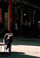 A local resting at a street cafe, Silk Route; Dunhuang, Jiuquan, Gansu Province, China.
