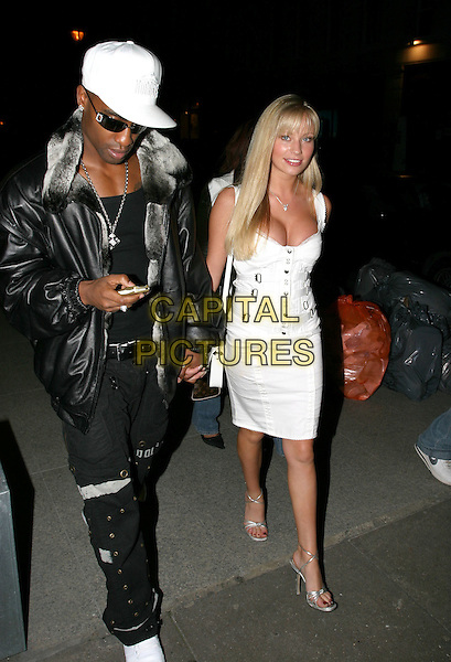 SIMON WEBBE & NATALIE DENNING.The Football Factory - UK Charity Film Premiere, Odeon, West End, London, WC2.May 10th, 2004.full length, full-length, Dening, white dress, white hat.www.capitalpictures.com.sales@capitalpictures.com.© Capital Pictures..