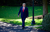 United States President Donald J. Trump walks towards the press prior to taking questions from the media as he prepares to depart the South Lawn of the White House in Washington, DC to deliver remarks at a Keep America Great Rally in Minneapolis, Minnesota on Thursday, October 10, 2019.<br /> Credit: Ron Sachs / CNP