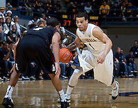December 29th, 2012: California's Justin Cobbs works against Harvard's  Siyani Chambers during a game at Haas Pavilion in Berkeley, Ca Harvard defeated California 67 - 62