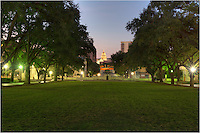 In the early morning hours, the Texas State Capitol building is still it up before sunrise. This viewpoint of the historic building was captured from the south mall of the University of Texas Campus.