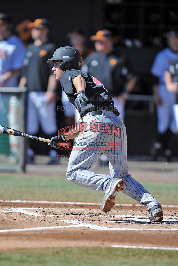 UNLV Runnin' Rebels shortstop Matt McCallister #4 swings at a pitch during a game against the Tennessee Volunteers at Lindsey Nelson Stadium on February 22, 2014 in Knoxville, Tennessee. The Volunteers defeated the Rebels 5-4. (Tony Farlow/Four Seam Images)