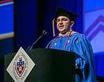 Michael Fernandez, student speaker, addresses fellow classmates Sunday, June 11, 2017, during the DePaul University Driehaus College of Business commencement ceremony at the Allstate Arena in Rosemont, IL. (DePaul University/Jamie Moncrief)