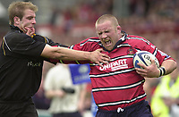 18/05/2002.Sport -Rugby Union- Zurich Championship Quarter final.Gloucester vs Newcastle.Phil Vickery hands off Grath Maclune on his way too his try..[Mandatory Credit, Peter Spurier/ Intersport Images].