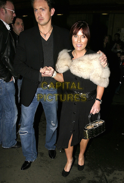 "DAVE MORGAN & JESSIE WALLACE.Leaving performance of ""Drallion"", Cirque du Soleil, Royal Albert Hall, London, January 6th 2005..full length boyfriend partner couple white fur cape wrap shawl black dress belt.Ref: AH.www.capitalpictures.com.sales@capitalpictures.com.©Capital Pictures."