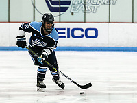 BOSTON, MA - JANUARY 04: Nicole Pateman #12 of University of Maine brings the puck forward during a game between University of Maine and Boston University at Walter Brown Arena on January 04, 2020 in Boston, Massachusetts.