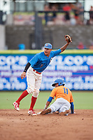 Clearwater Threshers shortstop Arquimedes Gamboa (7) shows the umpire the baseball after tagging Luis Carpio (11) as he slides into second base during a game against the St. Lucie Mets on August 11, 2018 at Spectrum Field in Clearwater, Florida.  St. Lucie defeated Clearwater 11-0.  (Mike Janes/Four Seam Images)