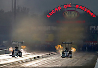 Aug 30, 2014; Clermont, IN, USA; NHRA top fuel dragster driver Morgan Lucas (right) races alongside Antron Brown during qualifying for the US Nationals at Lucas Oil Raceway. Mandatory Credit: Mark J. Rebilas-USA TODAY Sports