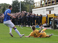 Scott Moore lunges in as Sebastien Faure watches in the Forres Mechanics v Rangers William Hill Scottish Cup 2nd Round match, at Mosset Park, Forres on 29.9.12.