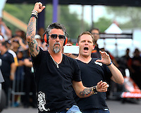 Apr 24, 2015; Baytown, TX, USA; Television personality Richard Rawlings (left) reacts as he watches NHRA top fuel dragster qualifying for the Spring Nationals at Royal Purple Raceway. Mandatory Credit: Mark J. Rebilas-