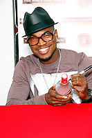 Serving as chief creative officer for Malibu's latest flavor innovation, Ne-Yo pictured in  Philadelphia today signing pre-purchased bottles of Malibu Red at PA Wine & Spirits Store on May 1, 2012  © Star Shooter / MediaPunchInc **SOLO*VENTA*EN*MEXICO**<br />