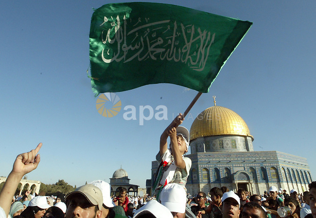 A Palestinian supporters of hamas attend a protest against the demolishing of Palestinian houses by Israeli municipality in front of the dome of the rocke at Al-Aqsa mosque  in the old city of Jerusalem on July 18, 2009. Photo by Mahfouz Abu Turk