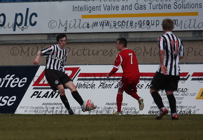 Sean Kelly clears before Stephen O'Neill tackles in the Aberdeen v St Mirren Clydesdale Bank Scottish Premier League Under 20 match played at Balmoor Stadium, Peterhead on 19.4.13.