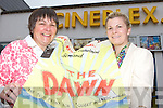 Michelle Cooper Galvin and her daughter Grainne with the original poster for the Movie The Dawn which her grandfather Tomas G Cooper produced and directed 75 years ago and are screening it in the Killarney Cinema next Monday and Tuesday night