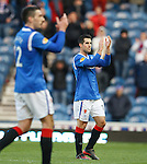 Carlos Bocanegra holds back tears after the match as he applauds the Rangers fans still in the stadium