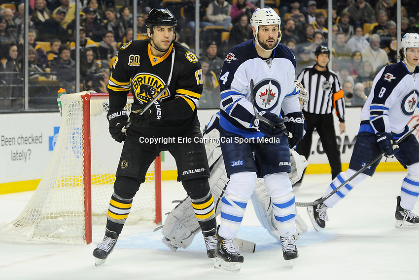 January 2, 2014 - Boston, Massachusetts, U.S. - Boston Bruins left wing Milan Lucic (17) and Winnipeg Jets defenseman Zach Bogosian (44) in game action during the NHL game between Winnipeg Jets and the Boston Bruins held at TD Garden in Boston Massachusetts.  Boston defeated Winnipeg 4-1 in regulation. Eric Canha/CSM
