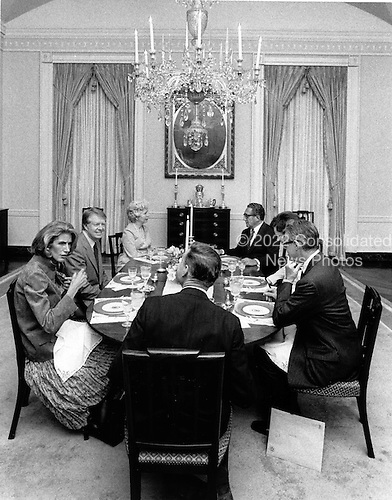 At dinner in the first floor dining room of the White House in Washington, DC, from left to right: Mrs. Nancy Kissinger, United States President Jimmy Carter, Mrs. Grace S. Vance, former US Secretary of State Dr. Henry A. Kissinger, first lady Rosalynn Carter, US Secretary of State Cyrus R. Vance and National Security Advisor Dr. Zbigniew K. Brzezinski on March 18, 1977.<br /> Credit: White House via CNP