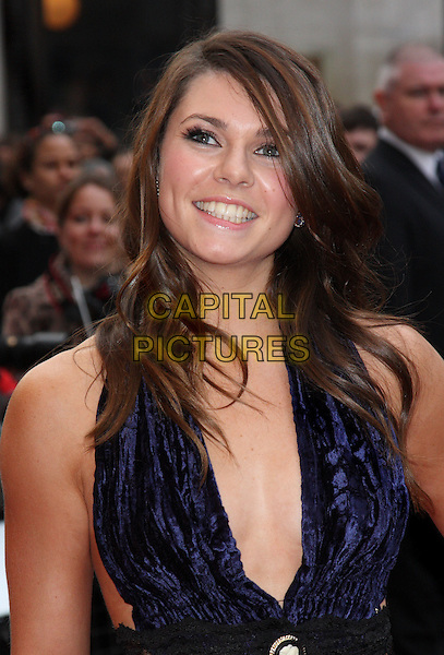 ALISON CARROLL .'The Kid' UK premiere held at the Odeon West End, Leicester Square, London, England..15th September 2010.headshot portrait blue crushed velvet dress black lace halterneck smiling cleavage plunging neckline .CAP/ROS.©Steve Ross/Capital Pictures