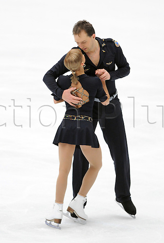 (091031) -- BEIJING, Oct. 31, 2009  -- Tatiana Volosozhar and Stanislav Morozov (R) of Ukraine perform during the pairs free skating at the ISU Grand Prix of Figure Skating 2009/2010 in Beijing, capital of China, Oct. 31, 2009. Tatiana Volosozhar and Stanislav Morozov won the bronze of the event with a total score of 170.79 points. Photo by Wang Qingqin/actiomplus. UK Licenses Only
