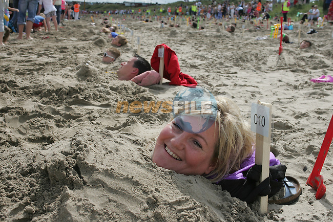 World Record ammount of people buried in the sand at the Prawn Festival in Clogherhead...Photo NEWSFILE/Jenny Matthews.(Photo credit should read Jenny Matthews/NEWSFILE)....This Picture has been sent you under the condtions enclosed by:.Newsfile Ltd..The Studio,.Millmount Abbey,.Drogheda,.Co Meath..Ireland..Tel: +353(0)41-9871240.Fax: +353(0)41-9871260.GSM: +353(0)86-2500958.email: pictures@newsfile.ie.www.newsfile.ie.FTP: 193.120.102.198.