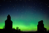 Northern lights (aurora borealis) and grain elevator in ghost town<br /> Bents<br /> Saskatchewan<br /> Canada