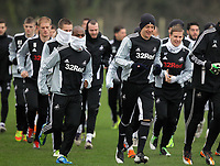 FAO SPORTS PICTURE DESK<br /> Pictured L-R: Leroy Lita and Garry Monk warming up. Tuesday 17 January 2012<br /> Re: Premier League side Swansea City Football Club training in Llandarcy, south Wales.