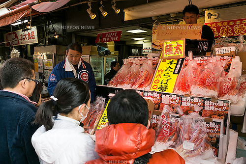 Year-end shoppers look at various products along the streets of Ameyoko in Ueno on December 30, 2015, Tokyo, Japan. Ameya Yokocho, often called ''Ameyoko,'' is a narrow street market filled with more than 500 retailers and is a popular spot to buy groceries in preparation for the New Years, which is one of the most important holidays in Japan. (Photo by Rodrigo Reyes Marin/AFLO)