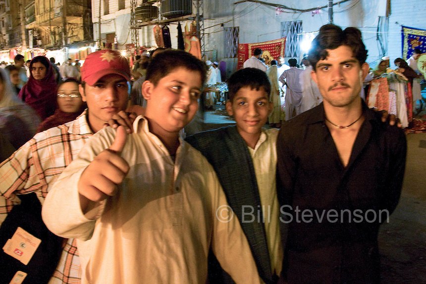 A group of boys at night in the old bazaar in Rawalpindi Pakistan