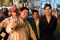 A group of boys at night in the old bazaar in Rawalpindi Pakistan