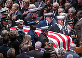 The casket carrying the remains of former United States President George H.W. Bush are brought in to the Washington National Cathedral to begin the National funeral service in honor of the late former President in Washington, DC on Wednesday, December 5, 2018.<br /> Credit: Ron Sachs / CNP<br /> (RESTRICTION: NO New York or New Jersey Newspapers or newspapers within a 75 mile radius of New York City)